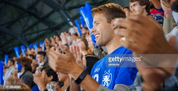 spectators in stadium - sport venue stock pictures, royalty-free photos & images