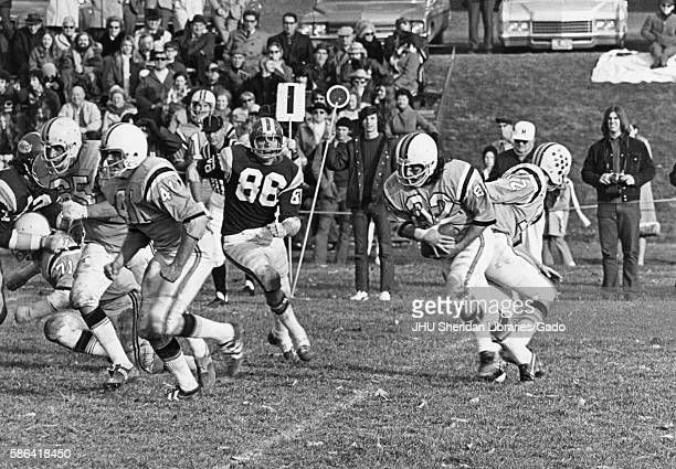 Spectators in the background watch a college football game between Johns Hopkins and Western Montana October 1972