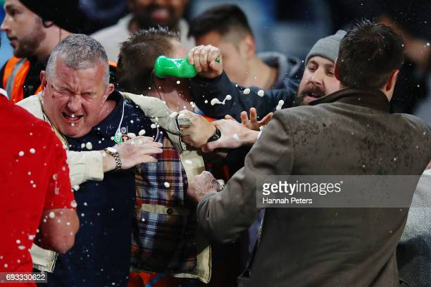 Spectators in the crowd fight during the match between the Auckland Blues and the British Irish Lions at Eden Park on June 7 2017 in Auckland New...