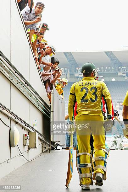Spectators in the crowd watch as Michael Clarke of Australia walks out to open the innings during the Cricket World Cup warm up match between...