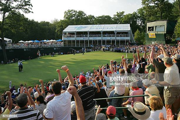 Spectators in the grandstand on the 18th green react as Sergio Garcia makes a birdie on the first playoff hole during the final round of The Barclays...