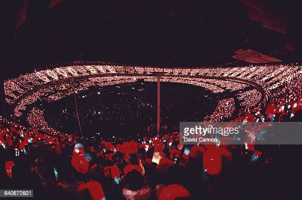 Spectators in the Olympic Stadium watch the Closing Ceremony of the XXIV Summer Olympic Games on 1 October 1988 at the Seoul Olympic Stadium in Seoul...