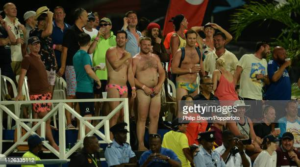 Spectators in the party stand look on during the first oneday international between the West Indies and England at Kensington Oval on February 20...