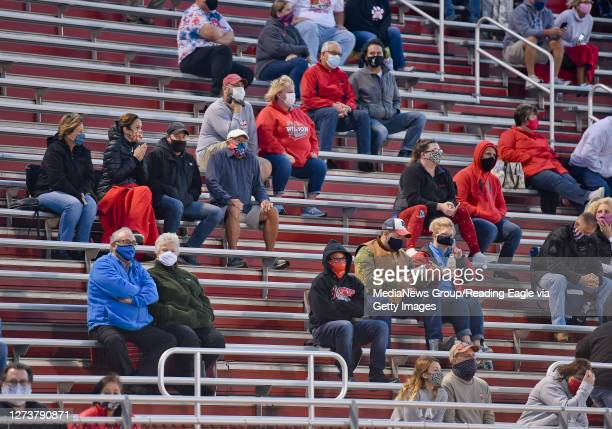 Spectators in the stands social distancing and wearing face masks. High School Football, the Gov. Mifflin Mustangs vs. The Wilson Bulldogs for the...
