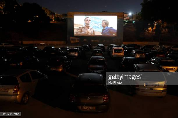Spectators in their cars watch the movie quotOnce Upon a Time in Hollywoodquot by US director Quentin Tarantino at a drivein theater as part of the...