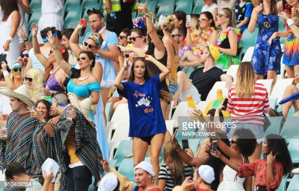Spectators in various fancy dress watch from the stands during the Sydney World Rugby Sevens Series tournament in Sydney on January 26 2018 / AFP...