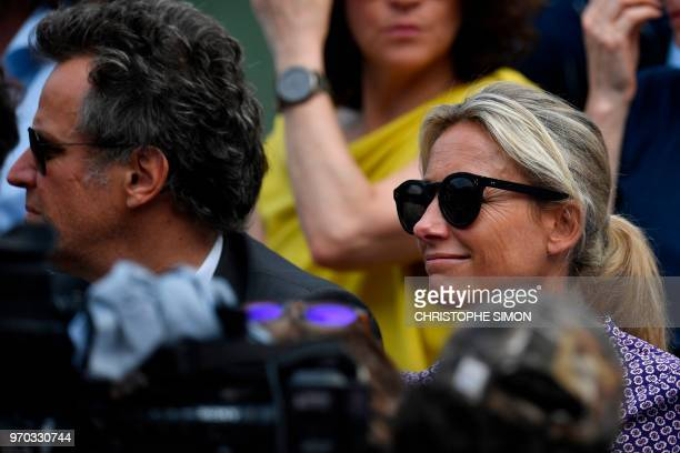 Spectators including French journalist AnneSophie Lapix look on as The SuzanneLenglen Cup arrives ahead of the women's singles final match between...