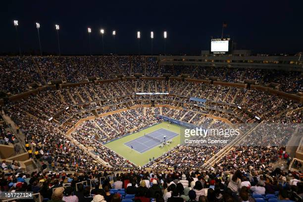 Spectators inside Arthur Ashe Stadium watch the men's singles final match between Andy Murray of Great Britain and Novak Djokovic of Serbia on Day...