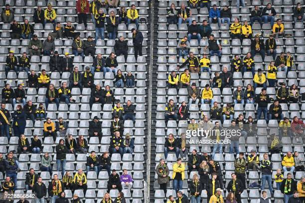 Spectators keep distance in the stands during the German first division Bundesliga football match Borussia Dortmund vs SC Freiburg in Dortmund, on...