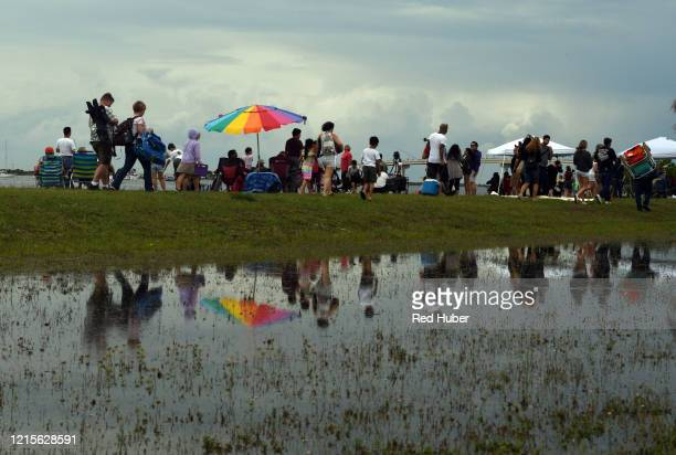 Spectators leave Marina Park after the scrubbed launch of a SpaceX rocket ship with two astronauts aboard at Cape Canaveral with less than 17 minutes...
