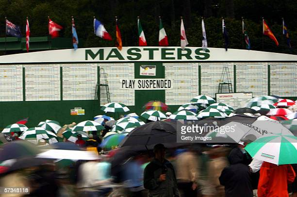 Spectators leave the grounds in a rain and lightning delay during the 3rd Round of The Masters at the Augusta National Golf Club on April 8, 2006 in...