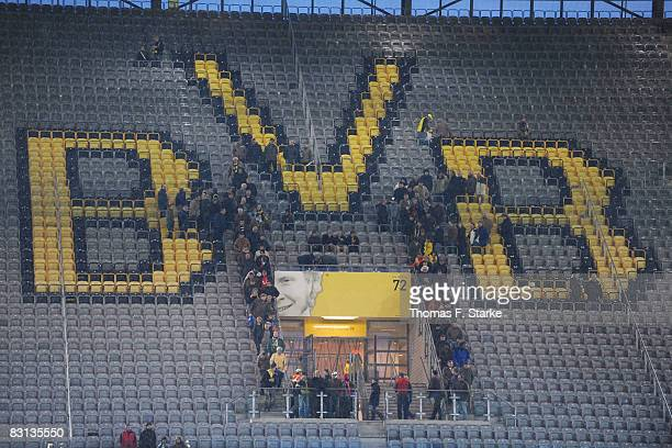 Spectators leave the main stand after the Bundesliga match between Borussia Dortmund and Hannover 96 at the Signal Iduna Park on October 5 2008 in...