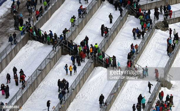 Spectators leave the stands at the ski stadium as the qualifying round of the skiflying World Championship has been cancelled due to strong winds on...