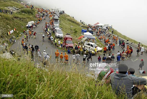 Spectators line the course as clouds shrouded the mountain on the final climb of stage 15 of the Tour de France from Bagneres-de-Bigorre to...