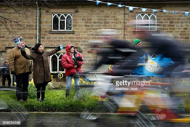 Spectators line the main street of Ripley as the riders of the Tour De Yorkshire cycle race pass on April 29, 2016 in Ripley, England. The first day...
