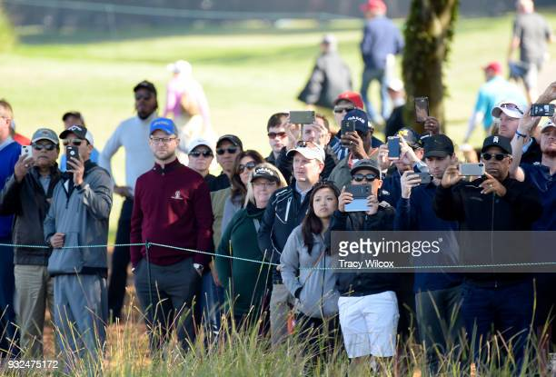 Spectators line the ropes at No 18 as Tiger Woods tees off during the first round of the Arnold Palmer Invitational presented by MasterCard at Bay...