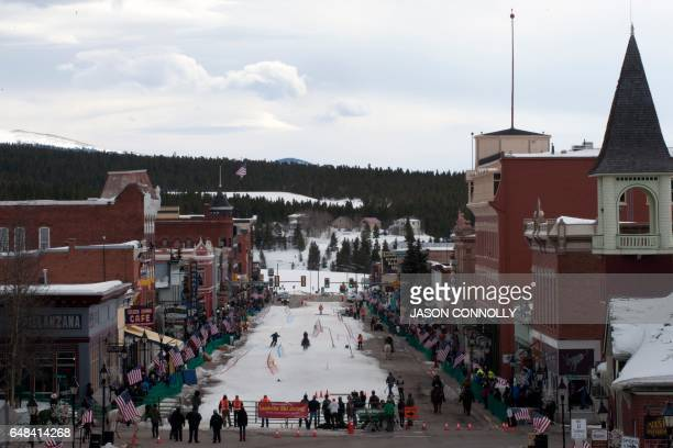 Spectators line the sidewalks of historic Harrison Avenue in Leadville Colorado to watch the 68th annual Leadville Ski Joring weekend competition on...