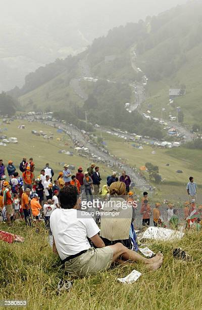 Spectators line the slopes of the final climb of stage 15 of the Tour de France from Bagneres-de-Bigorre to Luz-Ardiden on July 21, 2003 in France.