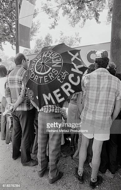 Spectators line up at the finish line in support of the cyclists in Parc des Princes. French cyclist Bernard Thevenet of team Peugeot won the overall...