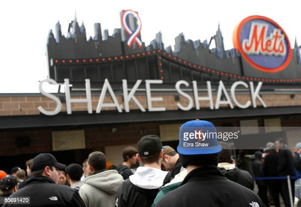 Spectators line up to get food at the Shake Shack during the Georgetown and St Johns game at Citi Field on March 29 2009 in the Flushing neighborhood...