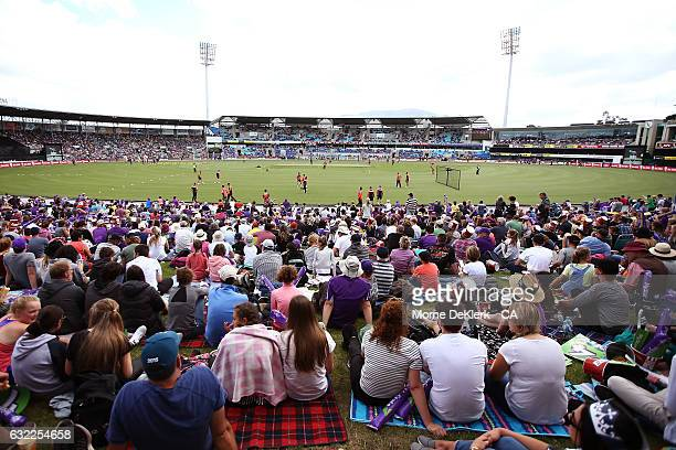 Spectators look as teams warm up before the Big Bash League match between the Hobart Hurricanes and the Perth Scorchers at Blundstone Arena on...
