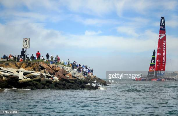 Spectators look at Emirates Team New Zealand 's AC72 shortly after the second finals race of the Louis Vuitton Cup in San Francisco California on...