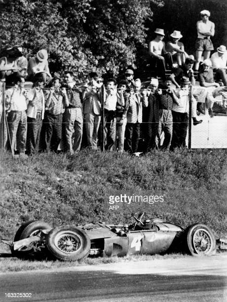 Spectators look at the Ferrari of German driver Wolfgang von Trips after it crashed into the crowd killing 15 people during the Italian Formula One...