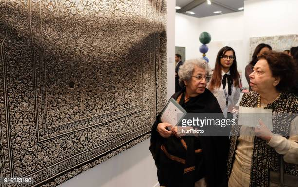"Spectators look at the oil on canvas painting by Italian artist Antonio Santin called ""Moebius Ballade 2018"" at the India Art Fair 2018..."