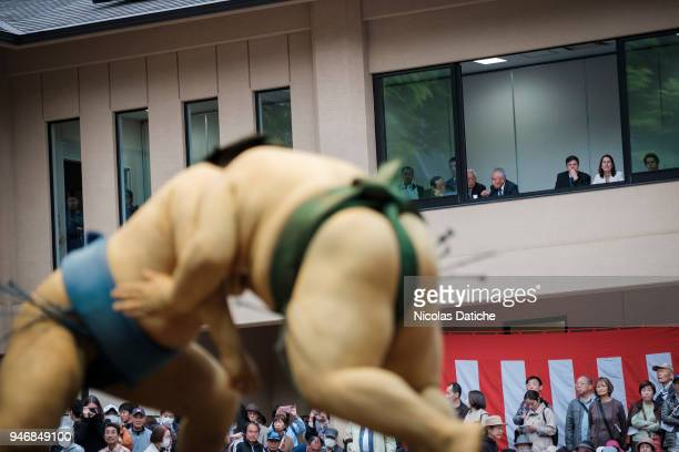 Spectators look at wrestlers fighting during 'Honozumo' ceremonial on April 16 2018 in Tokyo Japan This annual offering of a Sumo Tournament to the...