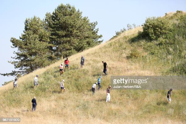 Spectators look for a lost ball during day four of The Ladies' British Open Amateur Championship at Hillside Golf Club on June 29 2018 in Southport...
