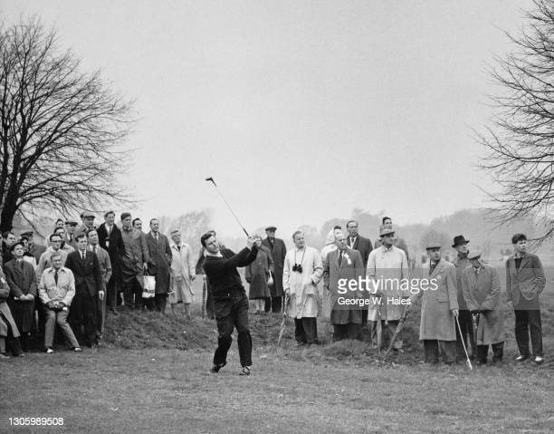Spectators look on as British golfer Peter Alliss plays an approach drive to the 2nd green during the Schweppes PGA Close Championship golf...