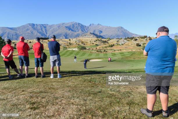 Spectators look on as Dimitrios Papadatos of Australia putts during day two of the New Zealand Open at The Hills on March 10 2017 in Queenstown New...