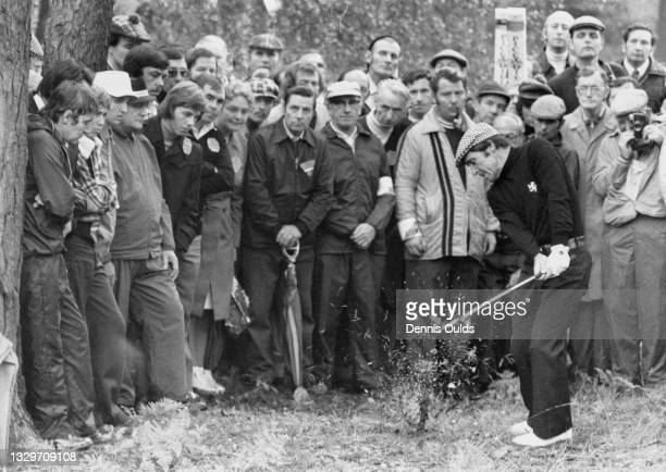 Spectators look on as Gary Player of South Africa plays an iron shot out of the rough on the 16th during the Piccadilly World Match Play Championship...