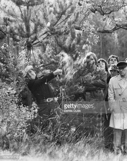 Spectators look on as Gary Player of South Africa plays an iron shot out of the rough on the 11th during the Piccadilly World Match Play Championship...
