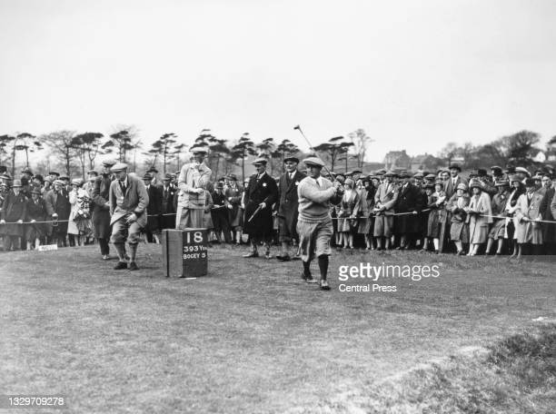 Spectators look on as Gene Sarazen of the United States watches his drive off the 18th tee during the 2nd Ryder Cup Matches against Great Britain on...