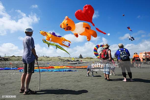 Spectators look on as kites fly during the 4th Otaki Kite Festival at Otaki Beach Marine Parade on March 6 2016 in Otaki New Zealand The Otaki Kite...