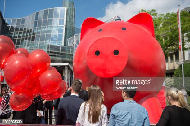 Spectators look on as the 'world's largest piggy bank' is being unveiled during a ceremony at Schillerplatz in Ludwigsburg Germany 18 May 2015 The...