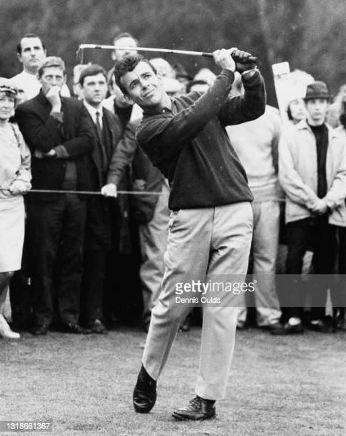 Spectators look on as Tony Jacklin of Great Britain drives off the 6th fairway during the semi final Piccadilly World Match Play Championship golf...