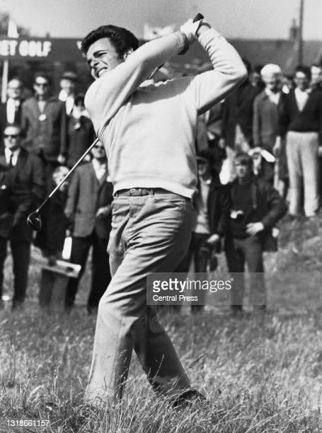 Spectators look on as Tony Jacklin of Great Britain drives out of the rough to the 15th green during the 98th Open Championship golf tournament on...
