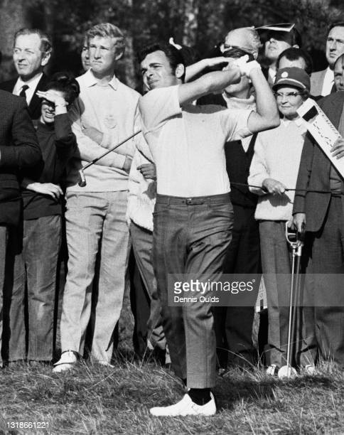 Spectators look on as Tony Jacklin of Great Britain drives out of the rough on the 4th fairway during the semi final Piccadilly World Match Play...