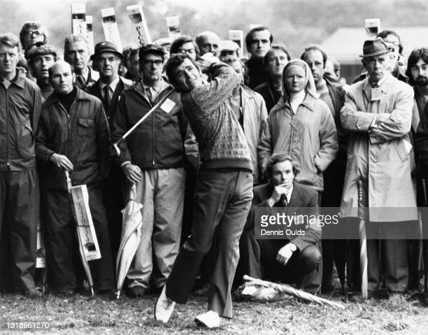 Spectators look on as Tony Jacklin of Great Britain drives out of the rough to the 18th green during the Piccadilly World Match Play Championship...