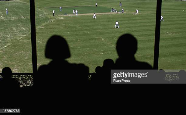 Spectators look on during day one of the tour match between the CA Invitational XI and England at the Sydney Cricket Ground on November 13 2013 in...