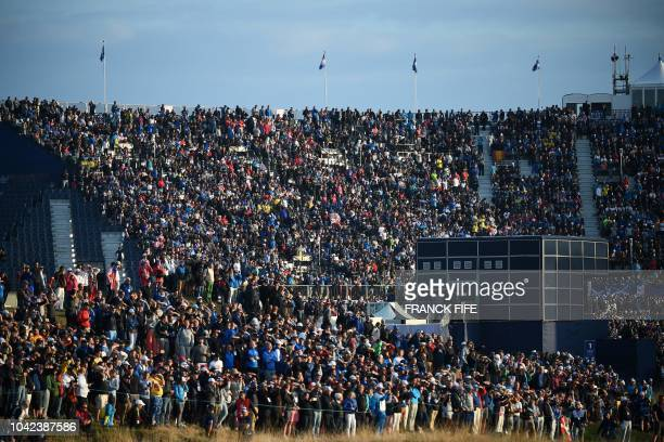 Spectators look on during on the first day of the 42nd Ryder Cup at Le Golf National Course at SaintQuentinenYvelines southwest of Paris on September...
