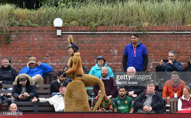 Spectators look on during the 2019 Cricket World Cup group stage match between Australia and Pakistan at The County Ground in Taunton southwest...