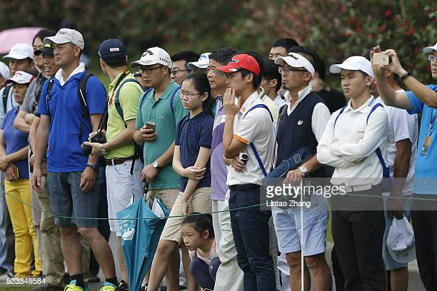 Spectators look on during the Bubba Watson of the United States plays a shot in he third round of the Shenzhen International at Genzon Golf Club on...