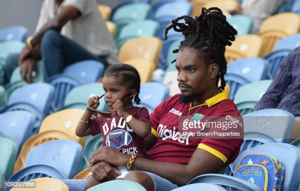 Spectators look on during the fourth day of the first Test match between the West Indies and England at Kensington Oval on January 26 2019 in...