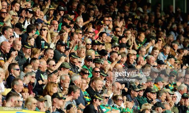 Spectators look on during the Gallagher Premiership Rugby match between Northampton Saints and Saracens at Franklin's Gardens on September 15 2018 in...