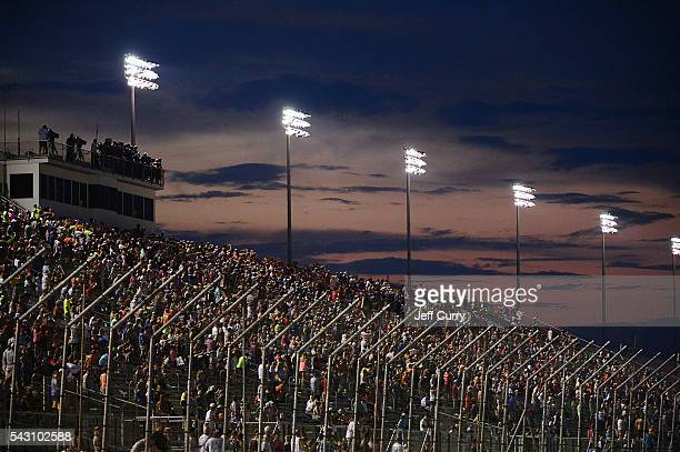 Spectators look on during the NASCAR Camping World Truck Series Drivin' for Linemen 200 at Gateway Motorsports Park on June 25 2016 in Madison...