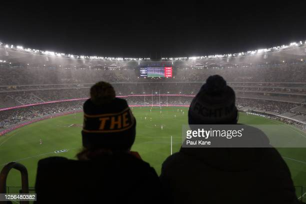 Spectators look on during the round 7 AFL match between the Geelong Cats and the Collingwood Magpies at Optus Stadium on July 16, 2020 in Perth,...