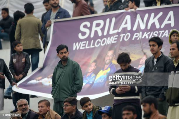 Spectators look on during the third day of the first Test cricket match between Pakistan and Sri Lanka at the Rawalpindi Cricket Stadium in...
